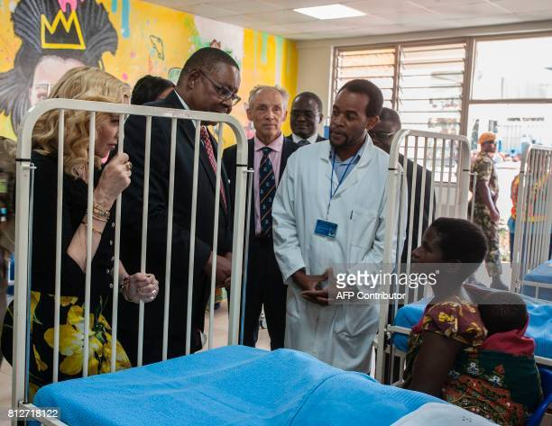US pop star Madonna and Malawi's president Arthur Peter Mutharika tour the Mercy James Children's Hospital during its opening ceremony at Queen...