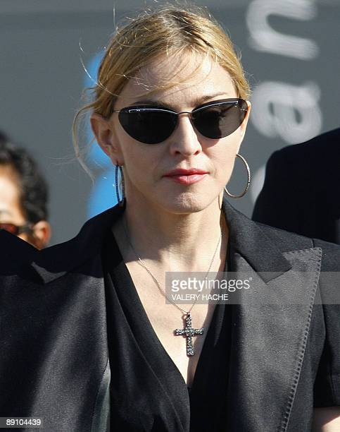 US pop star Madonna arrives in Marseille southern France on July 19 to meet technicians injured when part of her concert stage collapsed killing two...