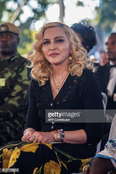 US pop star Madonna attends the opening ceremony of the Mercy James Children's Hospital at Queen Elizabeth Central Hospital in Blantyre Malawi on...