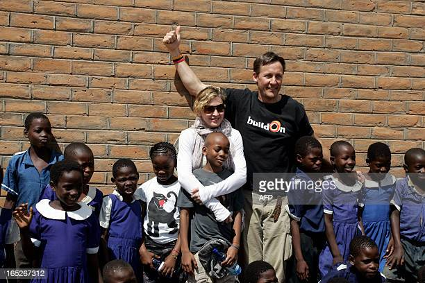 US Pop Star Madonna flanked by her Malawian adopted Children David and Mercy and BuildOn CEO Jim Ziolkowskiare are pictured on April 2 2013 oustide...