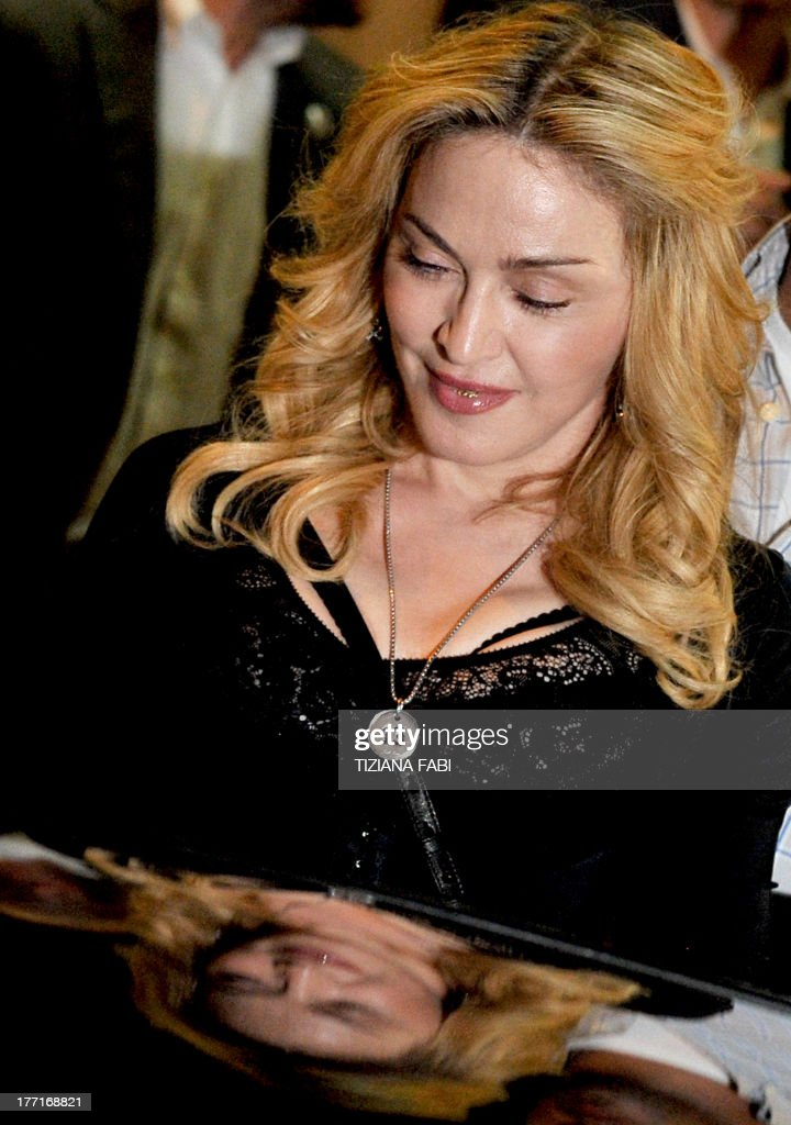 US pop star Madonna leaves after visiting a Hard Candy Fitness center in central Rome on August 21, 2013. The fitness clubs are part of a global chain she and her business partners are unveiling around the world.