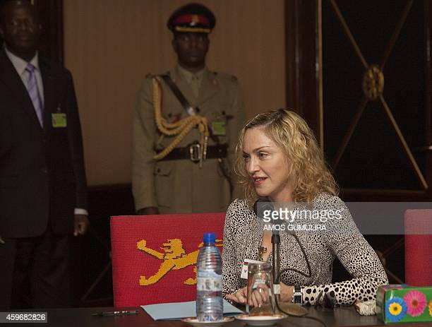 US pop Star Madonna makes a statement following her meeting with Malawi's president Professor Peter Mutharika at Kamuzu Palace in the Capital...