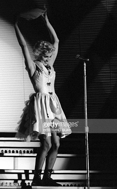 US pop star Madonna performs 28 August 1987 during a single concert held in the park of the town of Sceaux located in the southern suburb of Paris