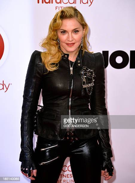 US pop star Madonna poses for photographers on the red carpet on the opening event of the Fitness Center Hard Candy on October 17 2013 in Berlin The...