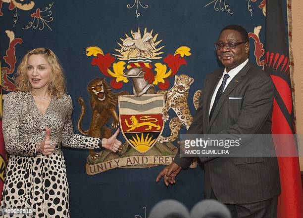 US pop Star Madonna poses with Malawi's president Professor Peter Mutharika prior to their meeting at Kamuzu Palace in the Capital Lilongwe on...