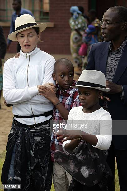 US Pop Star Madonna with her Malawian adopted son David and adopted daughter Mercy visits the Mphandula Childrens Carecentre in Namitete49km west of...