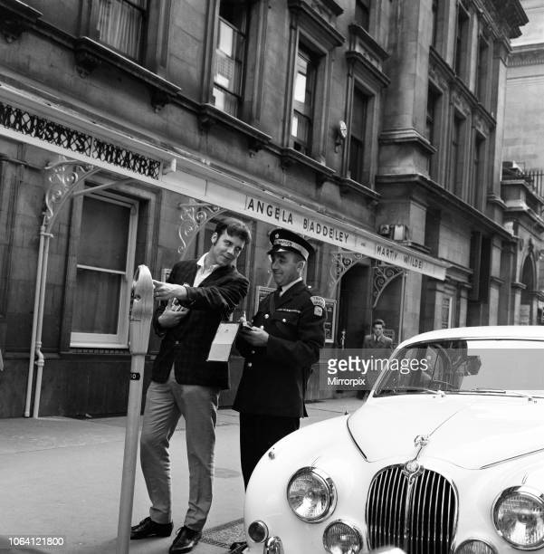 Pop star Marty Wilde is given a parking ticket after parking his cream Jaguar outside the London theatre where he is staring in the musical 'Bye Bye...