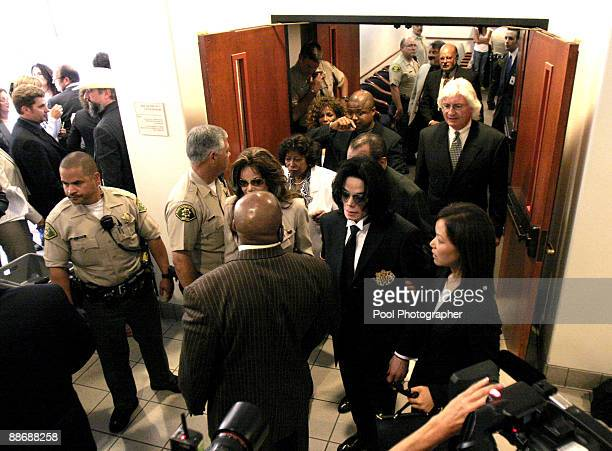 Pop star Michael Jackson and defense attorneys Susan Yu , Thomas Mesereau and Robert M. Sanger leave the courtroom after the jury in his child sex...