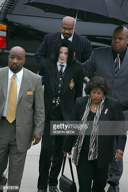 US pop star Michael Jackson arrives at the Santa Barbara County courthouse along with his mother Katherine and members of his entourage 12 April 2005...