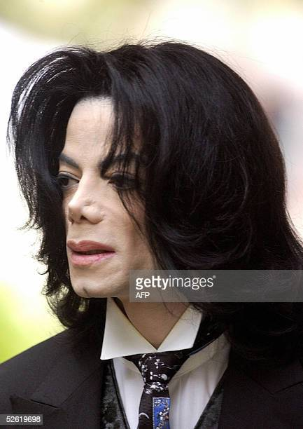 US pop star Michael Jackson arrives at the Santa Barbara County courthouse April 12 2005 in Santa Maria California for his child molestation trial...