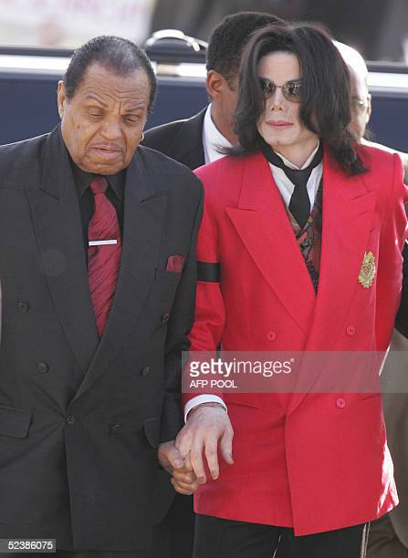 US pop star Michael Jackson arrives with his father Joe Jackson at the Santa Barbara County Courthouse in Santa Maria California 14 March 2005 for...