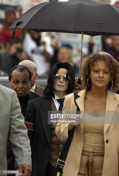 Pop star Michael Jackson arrives with his father Joe left and family member Carmela Jackson right for closing arguments in his child molestation...