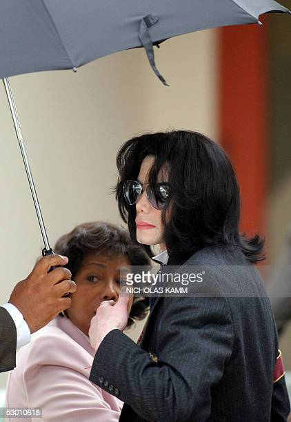 US pop star Michael Jackson arrives with his mother Katherine at the Santa Barbara County Superior Court 02 June in Santa Maria California Rival...