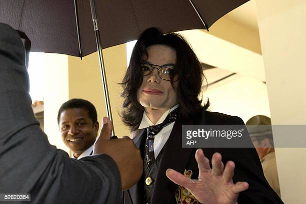 US pop star Michael Jackson exits the the Santa Barbara County courthouse 12 April 2005 in Santa Maria California The mother of Michael Jackson's...