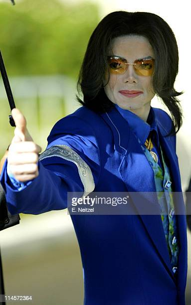 Pop star Michael Jackson gestures to his supporters while he enters the Santa Barbara Superior Court in Santa Maria Californial for the 13th day of...