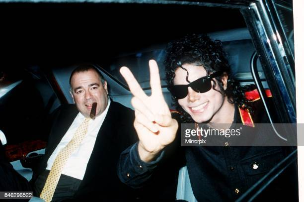 Pop star Michael Jackson gives the V sign as he arrives at Heathrow Airport for a concert tour July 1988
