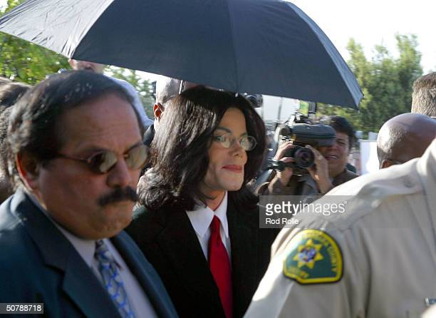 Pop Star Michael Jackson greets fans as he departs the Santa Maria courthouse April 30 2004 in Santa Maria California Jackson pleaded not guilty to...