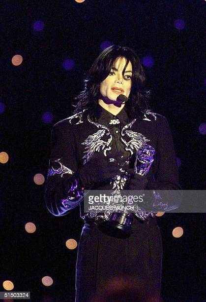 US pop star Michael Jackson holds his award during the World Music Awards ceremony at Monaco late 10 May 2000 Prince Albert of Monaco delivered the...