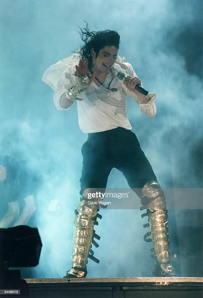 Pop star Michael Jackson in concert, wearing gold-coloured greaves, circa 2000.