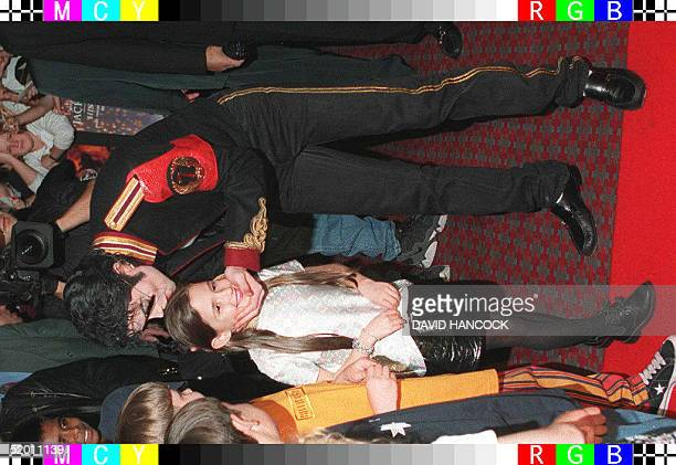 US pop star Michael Jackson kisses a young child as he arrives at the Australian premier of his movie Ghosts in Sydney 15 November Jackson married...