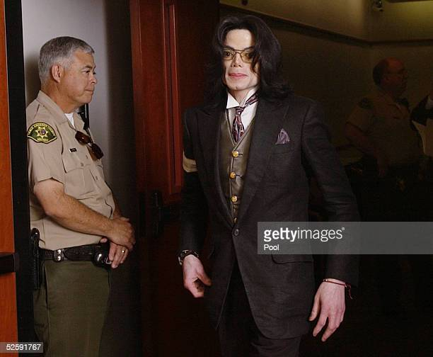 Pop star Michael Jackson leaves Santa Barbara County Superior Court at the end of the day in Michael's child molestation trial April 5 2005 in Santa...