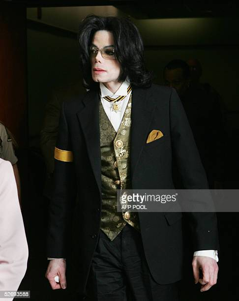Pop star Michael Jackson leaves the courtroom during a break at the Santa Barbara County courthouse 25 April in Santa Maria California during his...