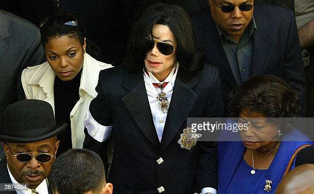 Pop star Michael Jackson leaves with mother Kathleen and sister singer Janet his arraignment for child molestation charges 16 January at the...