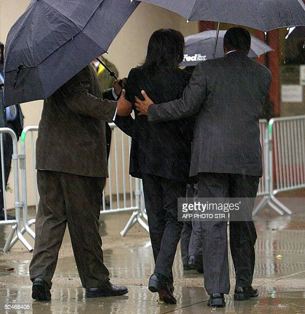 US pop star Michael Jackson needs some help from his bodyguards as he walks into the Santa Barbara County Courthouse in Santa Maria California 22...