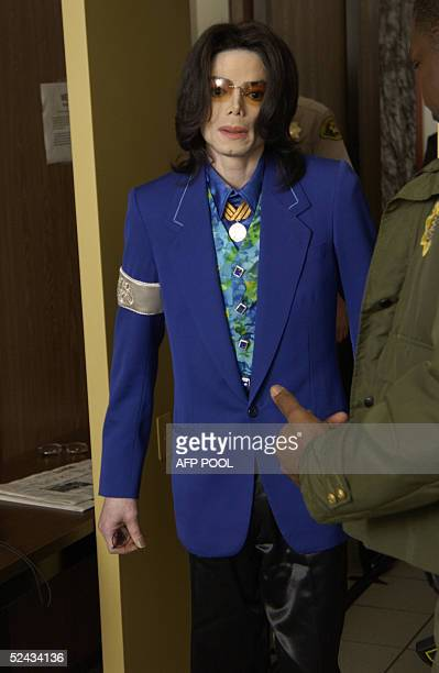 US pop star Michael Jackson passes through the metal detector as he heads to the courtroom 16 March 2005 at Santa Barbara County Courthouse in Santa...