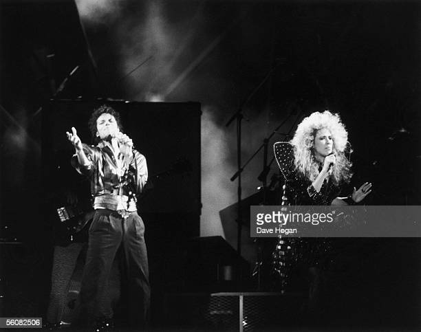 Pop star Michael Jackson teams up with backing singer Sheryl Crow for the duet 'I Just Can't Stop Loving You' during a 'Bad' World Tour concert in...