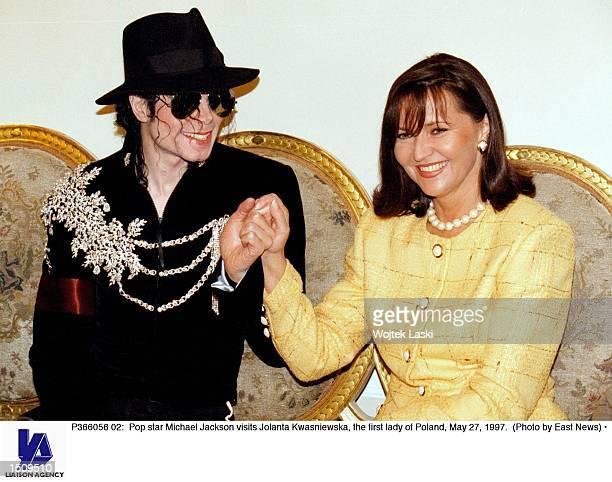Pop star Michael Jackson visits Jolanta Kwasniewska the first lady of Poland May 27 1997
