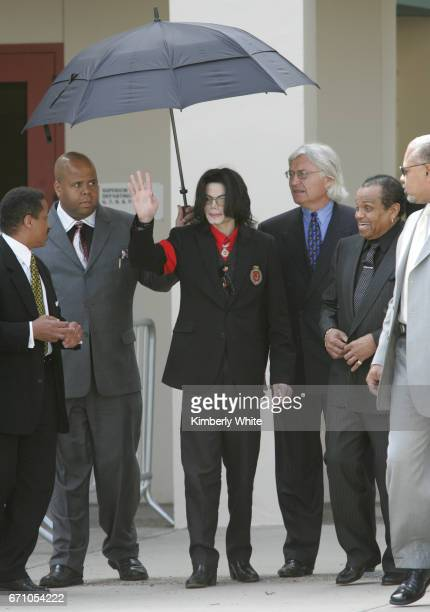 Pop star Michael Jackson waves to fans alongside his father Joe and lead attorney Thomas Mesereau Jr on leaving the Santa Barbara County Superior...