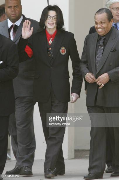 Pop star Michael Jackson waves to fans next to his father Joe on leaving the Santa Barbara County Superior Court in Santa Maria Jurors in Jackson's...