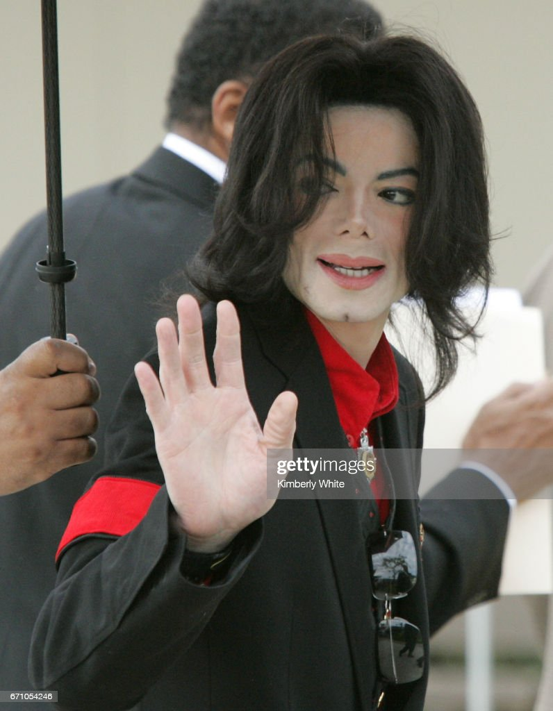 Pop star Michael Jackson waves to fans on arriving at the Santa Barbara County Superior Court, in Santa Maria. Jurors in Jackson's child molestation trial heard Thursday, fingerprint analysis of adult magazines found in his home was not completed until long after they were seized. Jackson is accused of molesting a boy at his Neverland ranch in 2003.