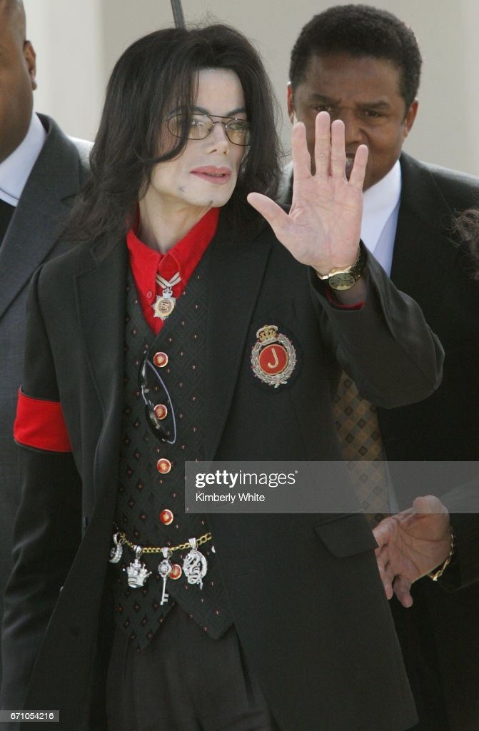 Pop star Michael Jackson waves to fans on leaving the Santa Barbara County Superior Court, in Santa Maria. Jurors in Jackson's child molestation trial heard Thursday, fingerprint analysis of adult magazines found in his home was not completed until long after they were seized. Jackson is accused of molesting a boy at his Neverland ranch in 2003.