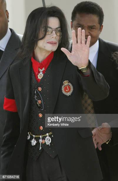 Pop star Michael Jackson waves to fans on leaving the Santa Barbara County Superior Court in Santa Maria Jurors in Jackson's child molestation trial...