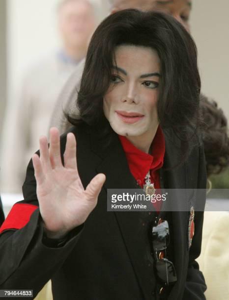 Pop star Michael Jackson waves to fans on leaving the Santa Barbara Superior County Court in Santa Maria Jurors in Jackson's child molestation trial...