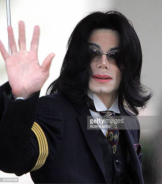 US pop star Michael Jackson waves to his fans as he arrives at Santa Barbara County Superior Court in Santa Maria California 07 April for another day...