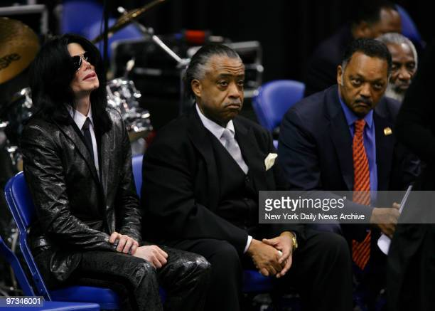 Pop star Michael Jackson weeps as he sits with the Rev Al Sharpton and the Rev Jesse Jackson during a service and public viewing for hometown legend...