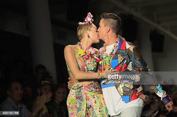 US pop star Miley Cyrus receives a kiss from Jeremy Scott as they walk the runway during his Spring/Summer 2015 collection at York Fashion Week...