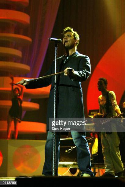 Pop star Robbie Williams performing at a dress rehearsal for the MTV European Music Awards 2002 held at the Palau Sant Jordi in Barcelona Spain on...