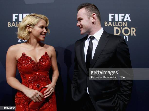 Pop star Shakira and Wayne Rooney of England arriving the red carpet during the FIFA Ballon d'Or Gala 2011 at the Kongresshaus on January 09 2012 in...