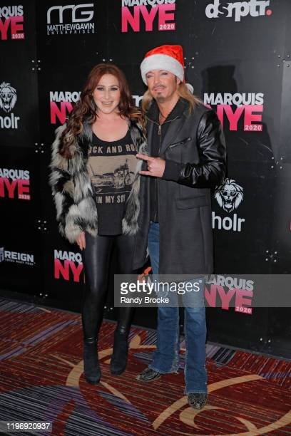 Pop Star Tiffany and event headliner Bret Michaels attend Marquis NYE 2020 at The New York Marriott Marquis on December 31 2019 in New York City