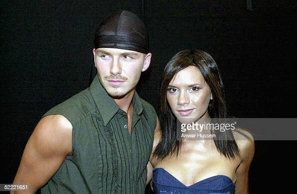 Pop star Victoria Beckham and her footballing husband David wait to meet the Prince of Wales at the Princes Trust Capital FM Party in the Park 2000...