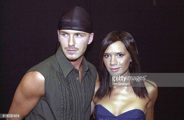 Pop Star Victoria Beckham making her solo debut at the Prince's Trust Capital FM Party in Hyde Park With her is husband David Beckham footballer