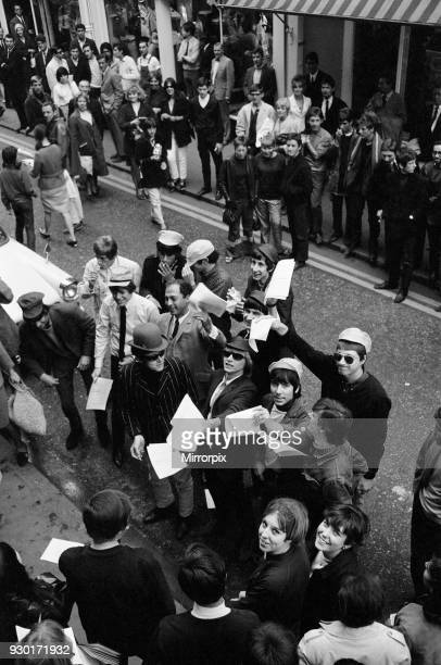 Pop stars meet in Carnaby Street London to become founder members of an anti bowlerhat group to be known as the bowler hat brigade Among the groups...