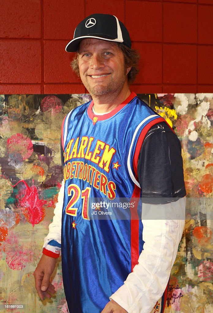 Pop Surrealist Artist Daniel Maltzman pose for a photograph during the unveiling of 'The Art & Soul Of Basketball' at Pan Pacific Recreation Complex on February 13, 2013 in Los Angeles, California.