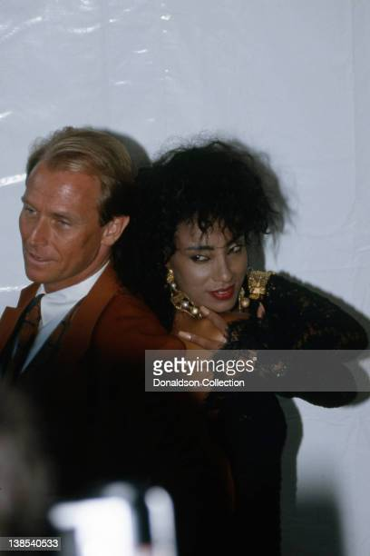 Pop VJ 'Downtown' Julie Brown and actor Corbin Bernsen attend the MTV Video Music Awards at the Gibson Amphitheatre on September 6 1989 in Los...
