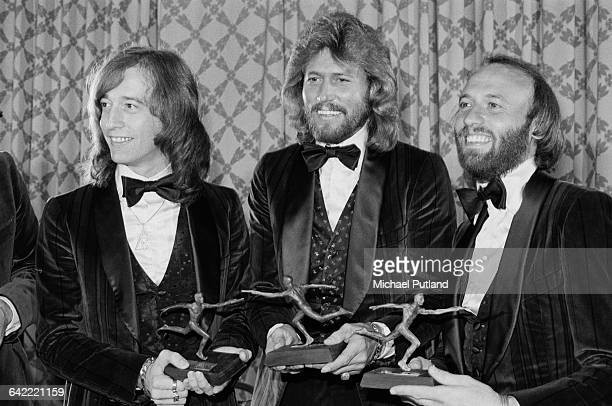 Pop vocal trio The Bee Gees after receiving the annual Superstars award given by the Police Athletic League for charity work at the Sheraton Center...