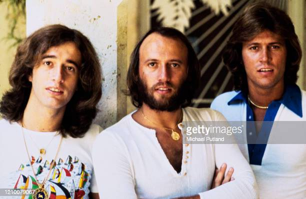 Pop vocal trio The Bee Gees posed together on 13th February 1976. The brothers are, from left, Robin Gibb , Maurice Gibb and Barry Gibb.